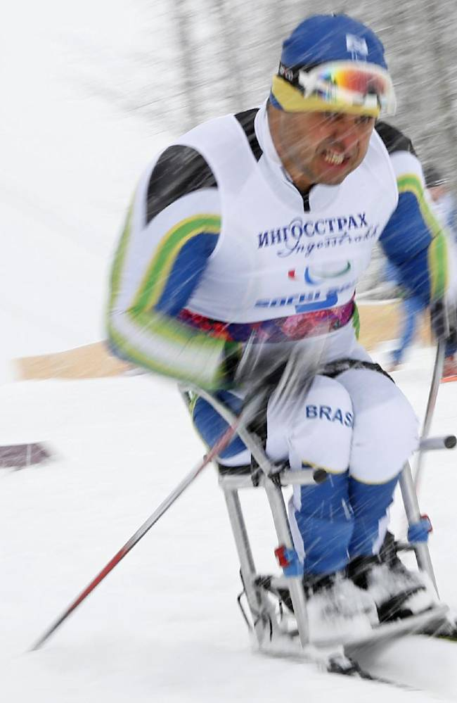 Fernando Rocha of Brazil races during the qualification round of the men's cross country 1km sprint, sitting event at the 2014 Winter Paralympic, Wednesday, March 12, 2014, in Krasnaya Polyana, Russia