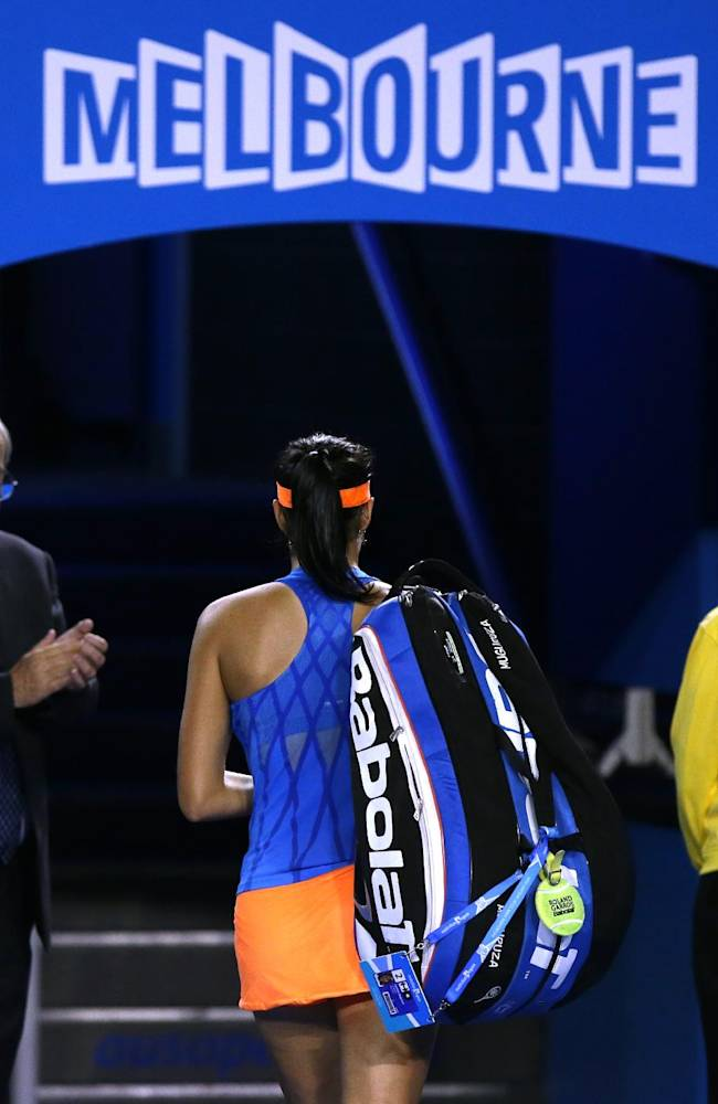 Garbine Muguruza of Spain walks off the court after her fourth round loss to Agnieszka Radwanska of Poland at the Australian Open tennis championship in Melbourne, Australia, Monday, Jan. 20, 2014