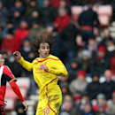 Liverpool's Lazar Markovic, right, vies for the ball with Sunderland's Adam Johnson, left, during their English Premier League soccer match at the Stadium of Light, Sunderland, England, Saturday, Jan. 10, 2015
