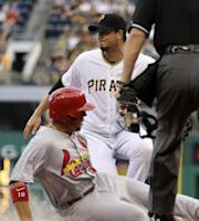 Pittsburgh Pirates starting pitcher Charlie Morton, center, covers home on a wild pitch as St. Louis Cardinals' Jon Jay scores from third during the second inning of a baseball game in Pittsburgh on Thursday, Aug. 1, 2013. (AP Photo/Gene J. Puskar)