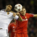 Basel's Mohamed Elneny, left, and Liverpool's Joe Allen battle for the ball during the Champions League Group B soccer match between Liverpool and FC Basel at Anfield Stadium in Liverpool, England, Tuesday, Dec. 9, 2014
