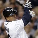 Detroit Tigers' Miguel Cabrera follows through on a solo home run against the Oakland Athletics in the seventh inning of a baseball game in Detroit, Wednesday, Sept. 19, 2012. (AP Photo/Paul Sancya)