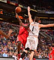 PHOENIX, AZ - FEBRUARY 23: Patrick Beverley #2 of the Houston Rockets shoots against the Phoenix Suns on February 23, 2014 at U.S. Airways Center in Phoenix, Arizona. (Photo by Barry Gossage/NBAE via Getty Images)