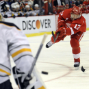 Detroit Red Wings center Pavel Datsyuk (13) of Russia, right, shoots the puck at Buffalo Sabres goalie Jhonas Enroth (1) of Sweden in the first period of an NHL hockey game at Joe Louis Arena in Detroit, Sunday, Jan. 18, 2015 The Associated Press