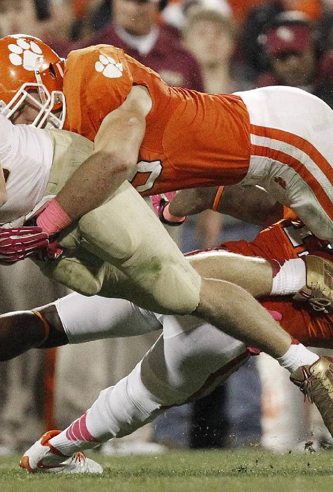 Florida State tight end Nick O'Leary (35) runs the ball against Clemson linebacker Spencer Shuey, top, and safety Travis Blanks, bottom, during the second half of an NCAA college football game, Saturday, Oct. 19, 2013, in Clemson, S.C