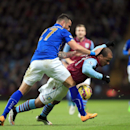 Leicester City's Danny Simpson, left, and Aston Villa's Gabriel Agbonlahor battle for the ball during their English Premier League soccer match at Villa Park, Birmingham, England, Sunday Dec. 7, 2014