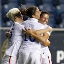 United States midfielder Carli Lloyd (10) celebrates her goal with teammates Megan Rapinoe (15) and Ali Krieger (11) in the first half against Mexico during a CONCACAF semifinal soccer match in Philadelphia, Pa., Friday, Oct. 24, 2014. (AP Photo/Rich Schultz)