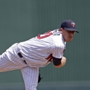 Minnesota Twins starting pitcher Kevin Correia pitches in the first inning of an exhibition spring baseball game against the New York Yankees in Fort Myers, Fla., Saturday, March 22, 2014 The Associated Press