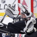 Los Angeles Kings goalie Jonathan Quick gets up after Chicago Blackhawks left wing Brandon Saad collided with him during the first period of an NHL hockey game, Wednesday, Jan. 28, 2015, in Los Angeles The Associated Press