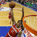Milwaukee Bucks' Brandon Knight (11) dunks past Philadelphia 76ers' Thaddeus Young during the first half of an NBA basketball game, Monday, Feb. 24, 2014, in Philadelphia The Associated Press