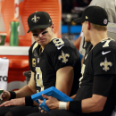 New Orleans Saints quarterback Drew Brees (9) sits with teammate Luke McCown (7) during the second half of an NFL football game Sunday, Sept. 28, 2014, in Arlington, Texas. The Associated Press
