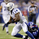 Indianapolis Colts' Hakeem Nicks (14) is tackled by New York Giants' Stevie Brown during the first half of an NFL preseason football game Saturday, Aug. 16, 2014, in Indianapolis The Associated Press