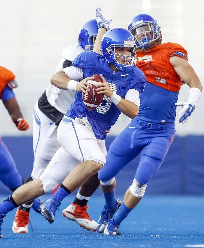 Boise State quarterback Grant Hedrick (9) looks for a receiver during an NCAA college football practice in Boise, Idaho, on Friday, Aug. 15, 2014