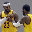 Cleveland Cavaliers' LeBron James (23) jokes with Kyrie Irving during the NBA basketball team's media day Friday, Sept. 26, 2014, in Independence, Ohio. (AP Photo/Mark Duncan)