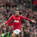 Manchester United's Robin van Persie takes the ball downfield during his team's English Premier League soccer match against Newcastle at Old Trafford Stadium, Manchester, England, Saturday Dec. 7, 2013