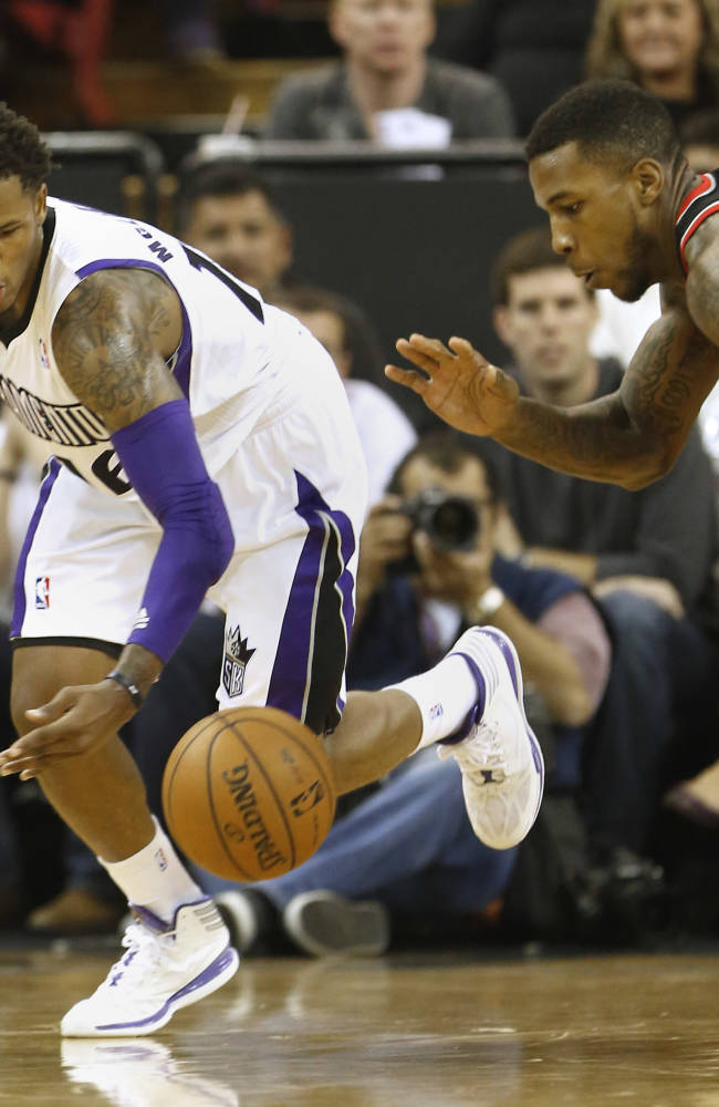 Sacramento Kings guard Ben McLemore, left, and Portland Trail Blazers forward Thomas Robinson chase after the ball during the  third quarter of an NBA basketball game in Sacramento, Calif., Saturday, Nov. 9, 2013.  The Trail Blazers won 96-85