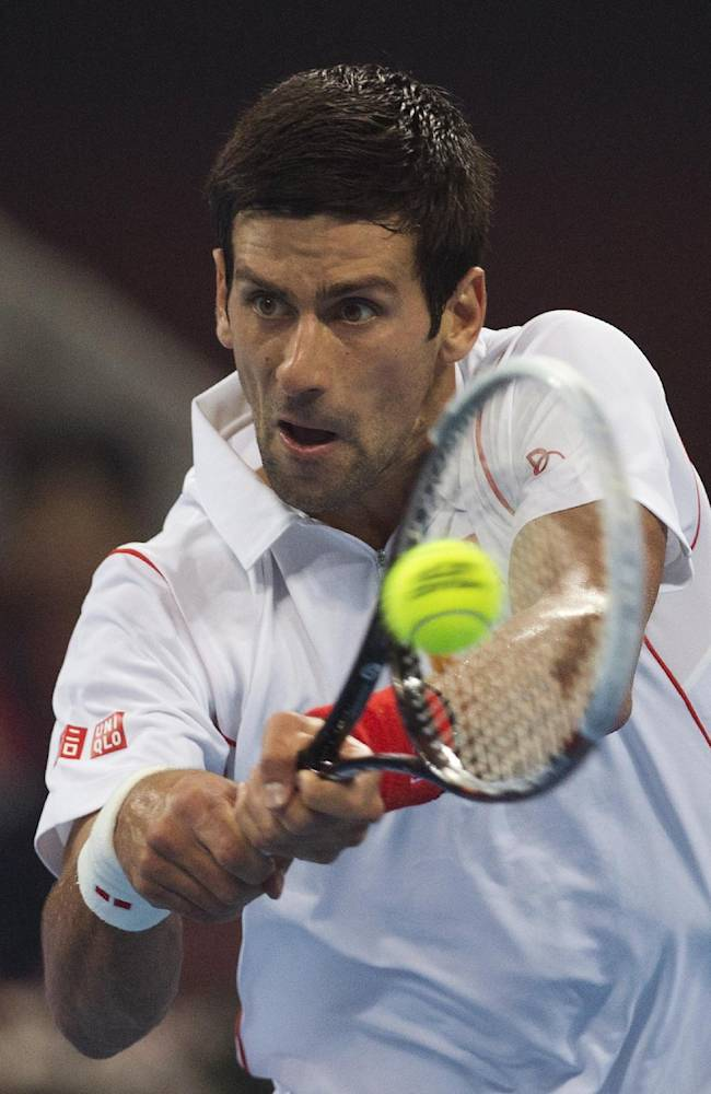 Novak Djokovic of Serbia returns a shot to Richard Gasquet of France during the semifinal match of the China Open tennis tournament at the National Tennis Stadium, in Beijing, China Saturday, Oct. 5, 2013. Djokovic defeated Gasquet 6-4, 6-2