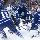 Toronto Maple Leafs goaltender Jonathan Bernier stops Dallas Stars' Ryan Garbutt as Leafs' Joffrey Lupul (19) and Korbinian Holzer (55) defend during the third period of an NHL hockey game, Tuesday, Dec. 2, 2014 in Toronto The Associated Press