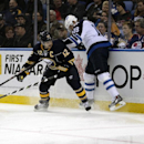 Buffalo Sabres right winger Brian Gionta (12) checks Winnipeg Jets center Bryan Little (18) as they battle for the puck during the first period of an NHL hockey game Wednesday, Nov. 26, 2014, in Buffalo, N.Y The Associated Press