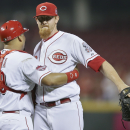 Votto hits 3 homers, Reds get 5 in all to beat Phillies 11-2 The Associated Press