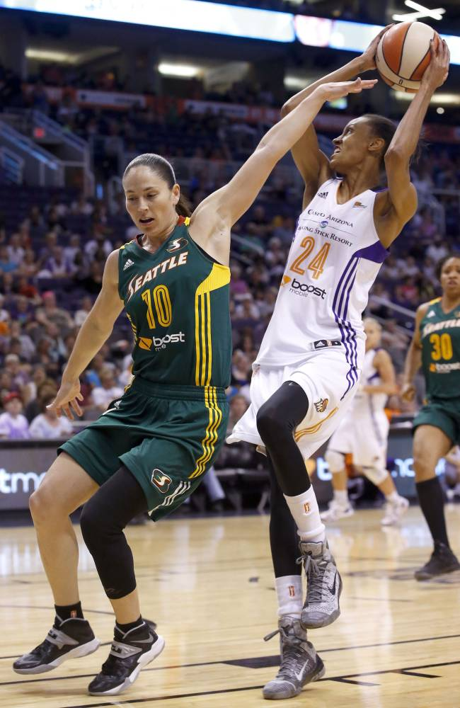 Phoenix Mercury's DeWanna Bonner (24) drives past Seattle Storm's Sue Bird (10) during the second half of a WNBA basketball game on Tuesday, June 3, 2014, in Phoenix