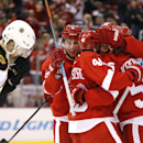 Detroit Red Wings left wing Justin Abdelkader, left, celebrates his goal as Boston Bruins Dougie Hamilton (27) skates by in the second period of an NHL hockey game in Detroit Thursday, Oct. 9, 2014 The Associated Press