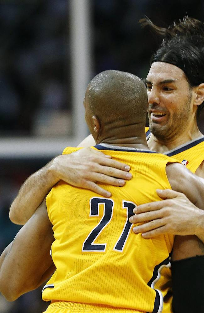 Indiana Pacers forward David West (21) celebrates with teammate Luis Scola (4) after hitting a basket late in the second half of Game 4 of an NBA basketball first-round playoff series against the Atlanta Hawks, Saturday, April 26, 2014, in Atlanta. The Pacers won 91-88 to even the series at two games apiece