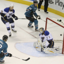 In this photo provided by SFBay, San Jose Sharks's Brent Burns (88) scores past St. Louis Blues goalie Brian Elliott (1) during the first period of an NHL hockey game on Friday, Nov. 29, 2013, in San Jose, Calif The Associated Press