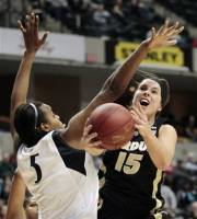 Purdue guard Courtney Moses (15) shoots around Penn State forward Talia East in the second half of an NCAA college basketball game during the semifinal round of the women's Big Ten Conference tournament in Indianapolis, Saturday, March 3, 2012. Purdue won 68-66. (AP Photo/AJ Mast)