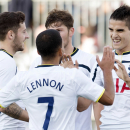 Tottenham Hotspur's Erik Lamela, right, celebrates his first goal of a friendly soccer game with teammates, from left to right, Ryan Mason, Aaron Lennon and Ben Davies during the first half against Toronto FC in Toronto on Wednesday, July 23, 2014