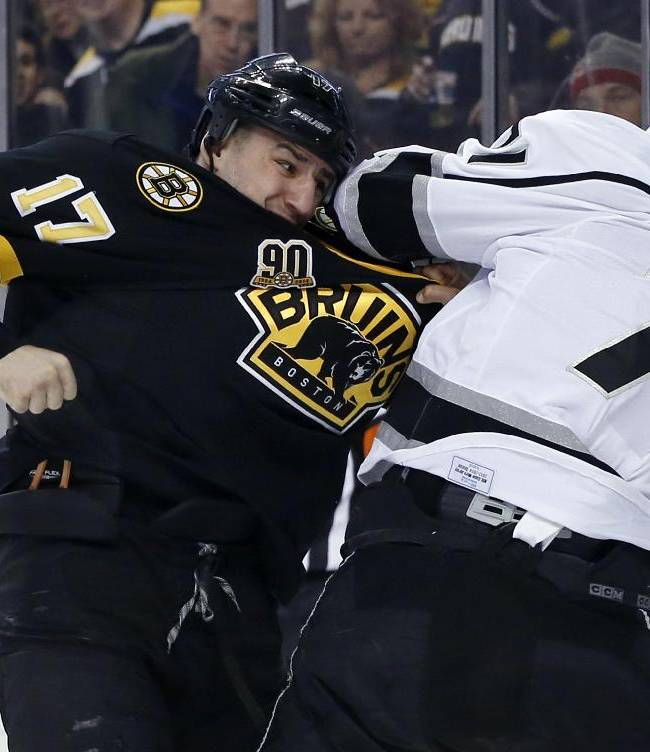 Boston Bruins left wing Milan Lucic (17) and Los Angeles Kings center Jordan Nolan (71) fight during the first period of an NHL hockey game in Boston Monday, Jan. 20, 2014