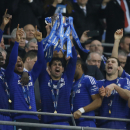 Chelsea's Diego Costa hold up the trophy after Chelsea won the English League Cup final soccer match between Chelsea and Tottenham at Wembley stadium in London, Sunday, March 1, 2015. Cheslea won the game 2-0. (AP Photo/Kirsty Wigglesworth)
