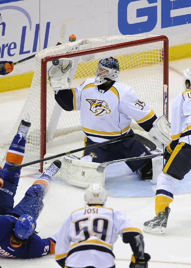 Nashville Predators' David Legwand (11) watches goalie Marek Mazanec (39) try to block a shot as New York Islanders' Colin McDonald (13) falls to the ice and New York Islanders' Michael Grabner (40) watches from behind the goal during the first period of an NHL hockey game on Tuesday, Nov. 12, 2013, in Uniondale, N.Y