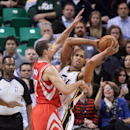 Houston Rockets' Francisco Garcia, left, defends against Utah Jazz's Richard Jefferson, right, in the first quarter of an NBA basketball game Monday, Dec. 2, 2013, in Salt Lake City The Associated Press