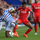 Queens Park Rangers' Leroy Fer, left, competes for the ball with Liverpool's Raheem Sterling, during the English Premier League soccer match between Queens Park Rangers and Liverpool, at Loftus Road, London, Sunday, Oct. 19, 2014