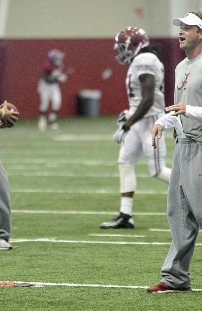 Alabama offensive coordinator/quarterbacks coach Lane Kiffin works with the quarterbacks and running backs during the NCAA college football team's spring practice, Tuesday, April 15, 2014, in Tuscaloosa, Ala