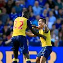 Arsenal's Alexis Sanchez, right, celebrates scoring his side's first goal of the game with teammate Yaya Sanogo during their English Premier League soccer match against Leicester City at the King Power Stadium, Leicester, England, Sunday, Aug. 31, 2014. (