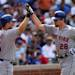 New York Mets' Daniel Murphy, right, is congratulated by teammate David Wright after hitting solo home run in the eighth inning of a baseball game against the Chicago Cubs in Chicago, Sunday, May 19, 2013