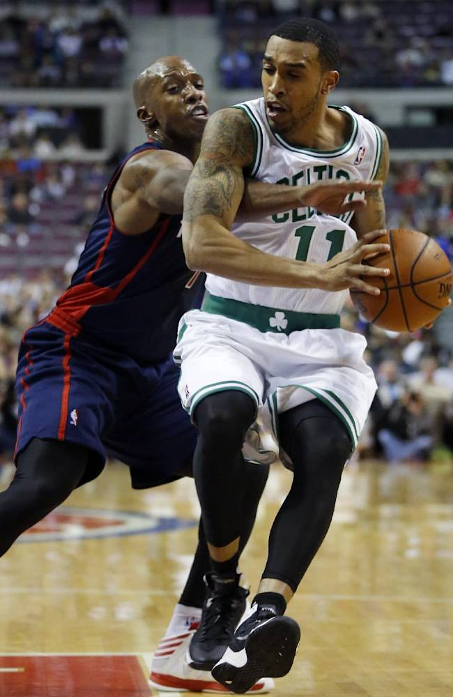 Detroit Pistons guard Chauncey Billups, left, tries to steal the ball from Boston Celtic guard Courtney Lee (11) during the first half of an NBA basketball game Sunday, Nov. 3, 2013, in Auburn Hills, Mich