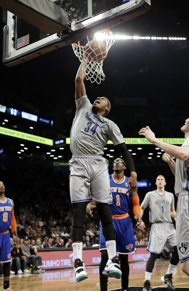 Brooklyn Nets' Paul Pierce (34) dunks in front of New York Knicks' Amare Stoudemire (1) during the first half of an NBA basketball game Tuesday, April 15, 2014, in New York