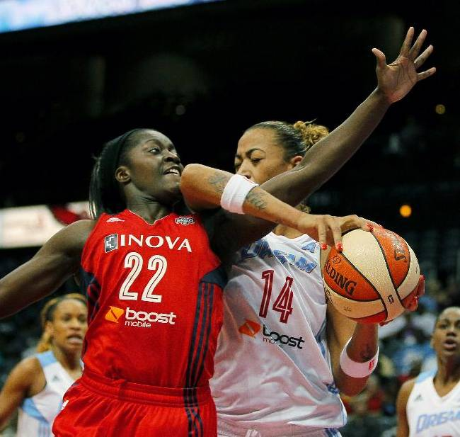 Atlanta Dream's Erika de Souza (14) is fouled by Washington Mystics guard Matee Ajavon (22) in Game 1 of anWNBA basketball Eastern Conference semifinals series, Thursday, Sept. 19, 2013, in Atlanta