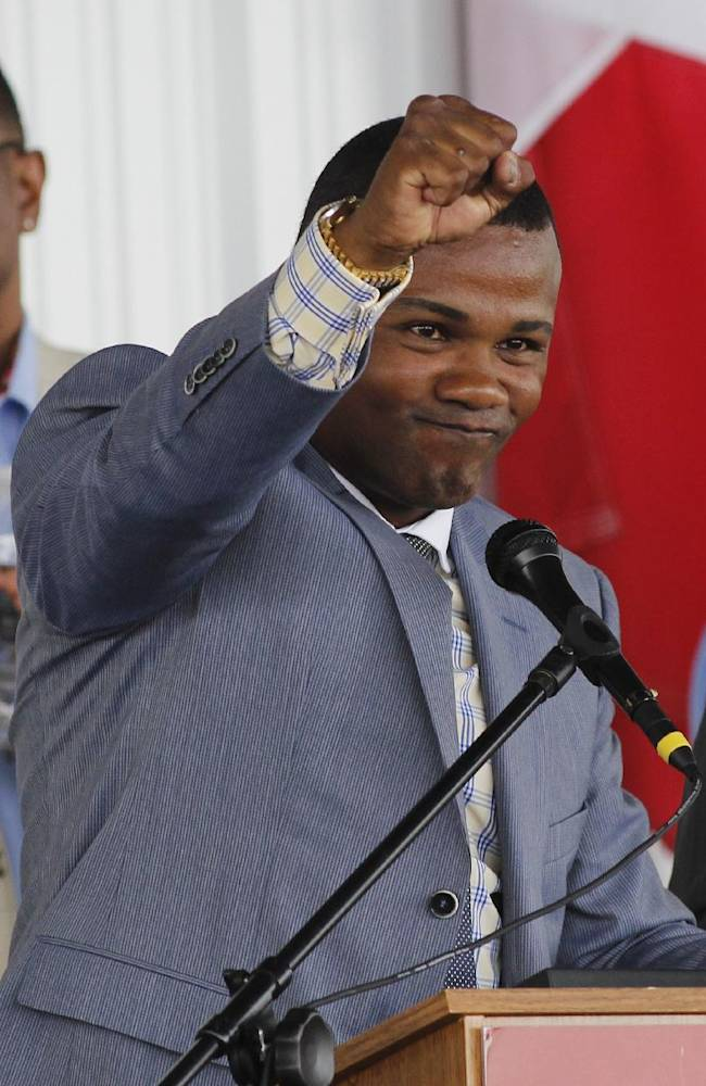 International Boxing Hall of Fame 2014 inductee Felix Trinidad reacts to cheering from the crowd during the Hall of Fame Induction ceremony in Canastota, N.Y, Sunday, June 8, 2014