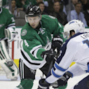 Dallas Stars defenseman Jason Demers (4) passes the puck against Winnipeg Jets left wing Andrew Ladd (16) during the first period of an NHL hockey game Tuesday, Dec. 9, 2014, in Dallas The Associated Press