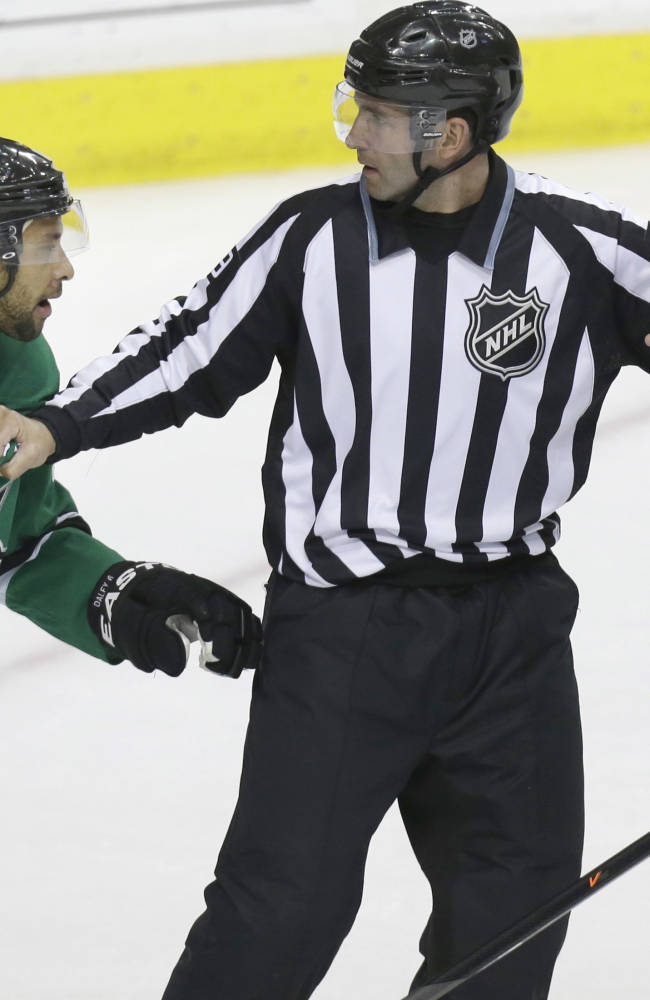 Linesman Steve Miller, center, keeps Dallas Stars defenseman Trevor Daley (6) and Anaheim Ducks right wing Corey Perry (10) apart during the second period of Game 6 of a first-round NHL hockey playoff series in Dallas, Sunday, April 27, 2014
