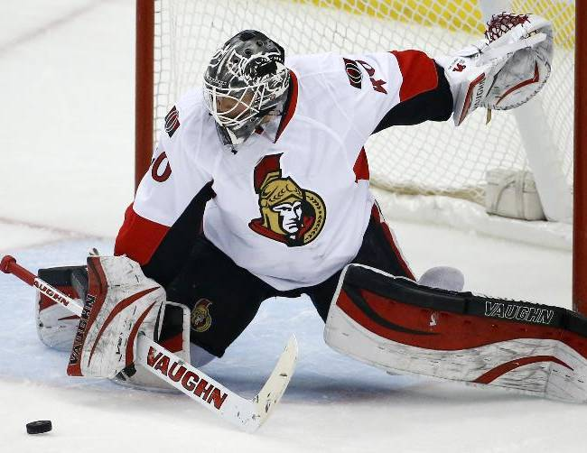 A shot by Pittsburgh Penguins' Jussi Jokinen nears Ottawa Senators goalie Robin Lehner before getting past for a goal in the first period of an NHL hockey game in Pittsburgh, Sunday, April 13, 2014