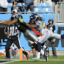 Carolina Panthers wide receiver Kelvin Benjamin (13) tires to make the catch against Seattle Seahawks cornerback Richard Sherman (25) during the second half of an NFL football game, Sunday, Oct. 26, 2014, in Charlotte The Associated Press