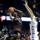 Louisville guard Russ Smith, left, drives to the basket against DePaul forward Donnavan Kirk during the first half of an NCAA college basketball game in Rosemont, Ill., on Wednesday, Feb. 27, 2013. (AP Photo/Nam Y. Huh)