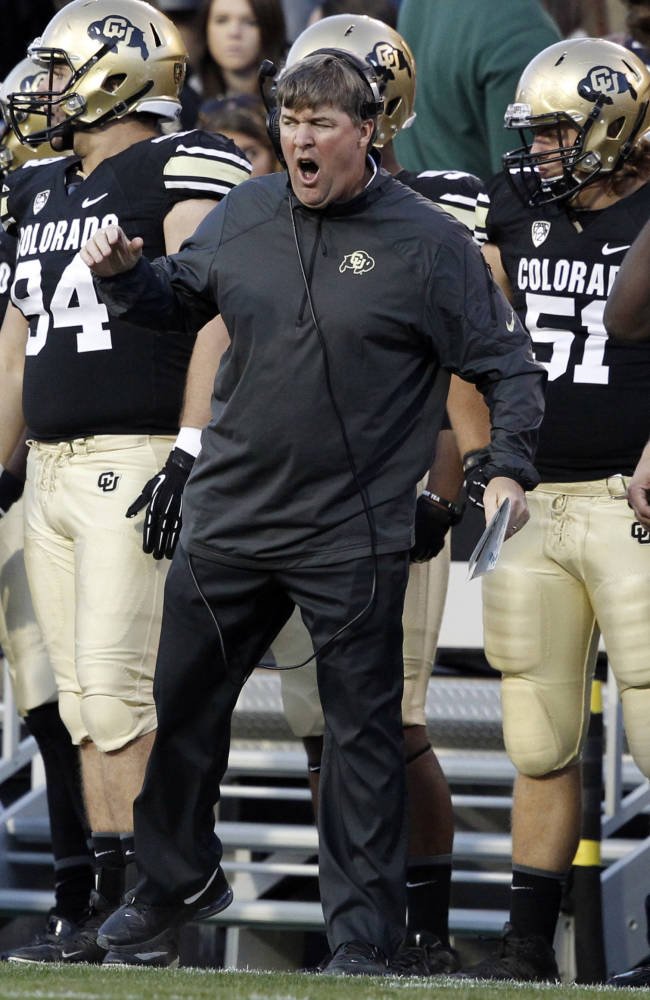 Colorado head coach Mike MacIntyre reacts to a call against his team while facing Oregon in the third quarter of Oregon's 57-16 victory in an NCAA college football game in Boulder, Colo., on Saturday, Oct. 5, 2013