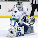 Vancouver Canucks goalie Eddie Lack (31) makes a pad-save during the second period of an NHL hockey game against the Pittsburgh Penguins in Pittsburgh, Thursday, Dec. 4, 2014. The Canucks won 3-0 The Associated Press