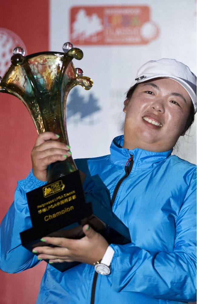 China's Feng Shanshan holds her trophy after winning the Reignwood LPGA Classic golf tournament at Pine Valley Golf Club on the outskirts of Beijing, China, Sunday, Oct. 6, 2013
